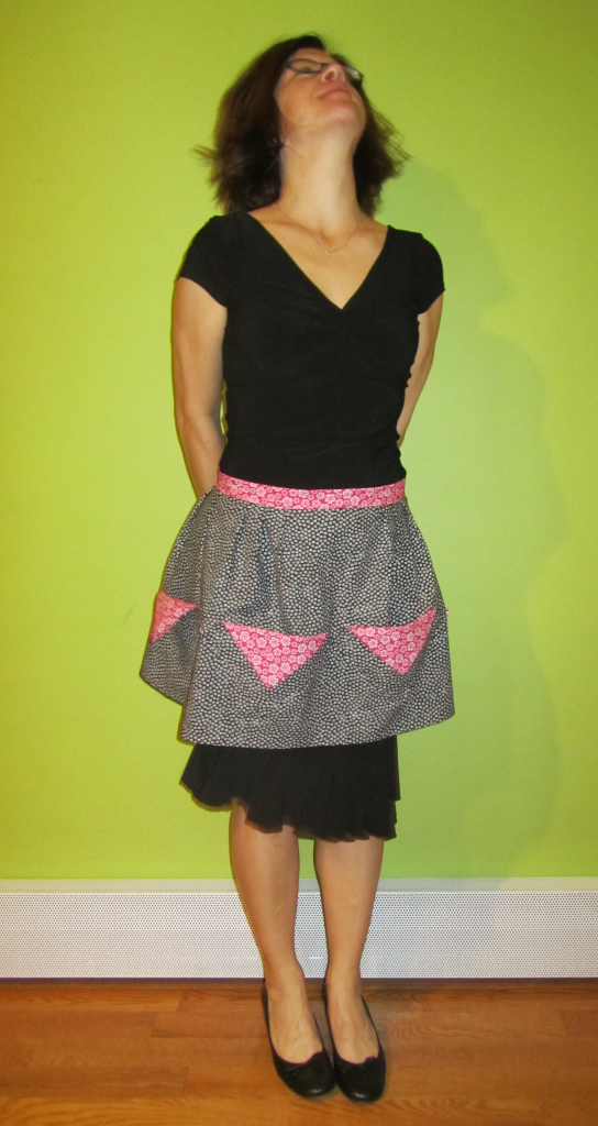 black and pink half apron