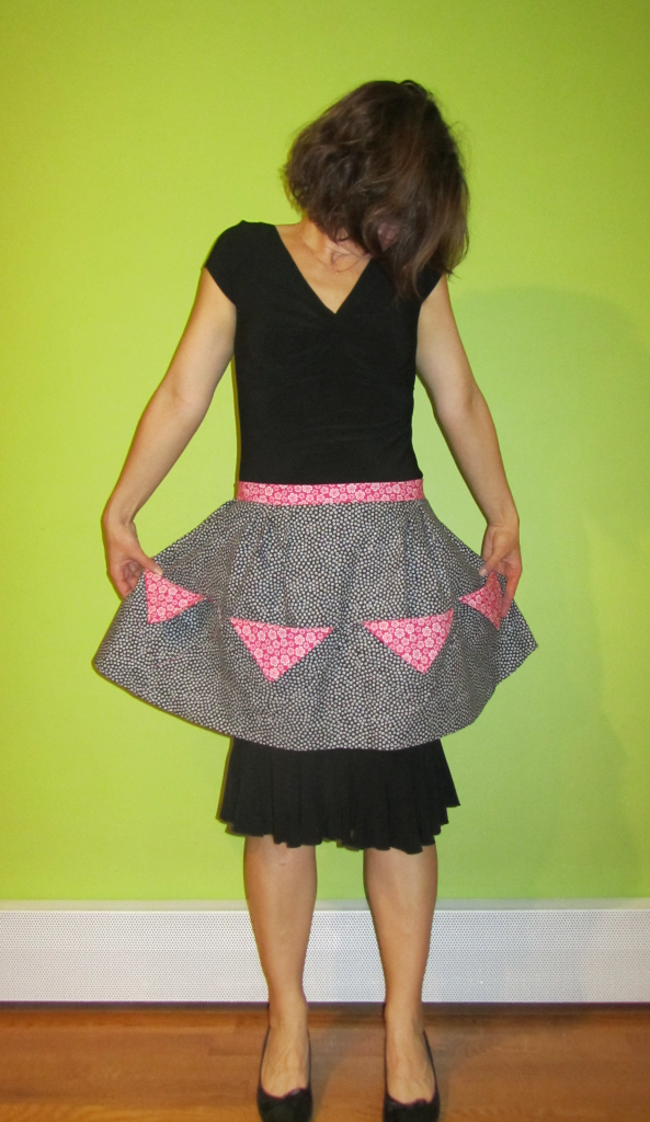 black and pink half apron - extended view